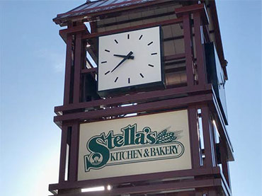 Clock with Stella's Kitchen and Bakery Logo